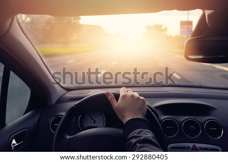 The road to success - a driver traveling on a road to the sun Royalty-Free Stock Photo #292880405