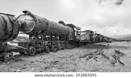 UYUNI, BOLIVIA - JANUAR 05, 2014: Antique train cemetery (black and white) #292883045
