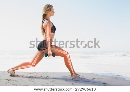 Digital composite of Highlighted bones of exercising woman Royalty-Free Stock Photo #292906613