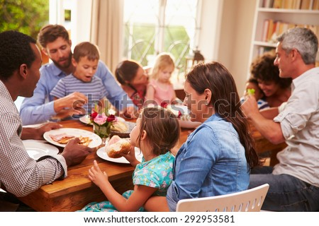 Family and friends sitting at a dining table #292953581