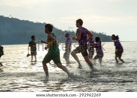 LANGSUAN, THAILAND - JUNE 21, 2015: Unidentified contestants in Annual run through the sea to PITHAK ISLAND  Langsuan Mini Marathon 11 th #292962269