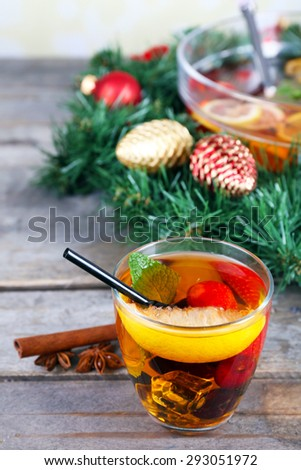Sangria in bowl and glass with Christmas decoration on wooden table close up #293051972