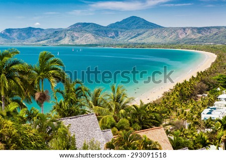 Port Douglas beach and ocean on sunny day, Queensland, Australia Royalty-Free Stock Photo #293091518
