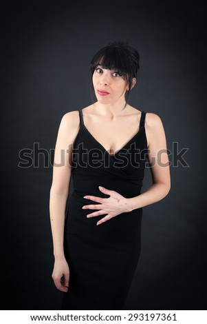 Beautiful woman doing different expressions in different sets of clothes: hungry #293197361