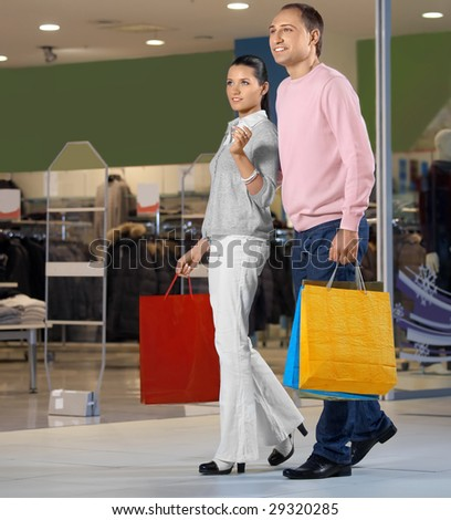 Young married couple in shop against show-windows #29320285