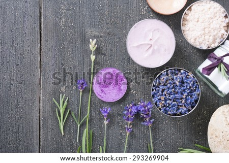 beauty product samples with fresh purple and blue dried lavenders, bath salts on dark wood table background #293269904