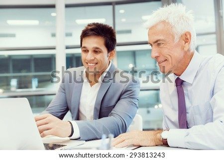 Two businessmen in fornt of computer in office #293813243