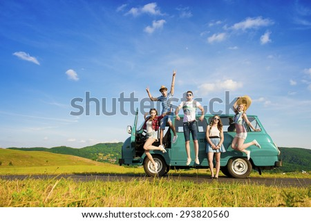 Young hipster friends on road trip on a summers day Royalty-Free Stock Photo #293820560