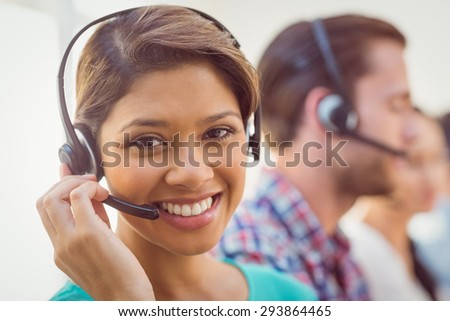 Close up plan of a smiling businesswoman in a call centre #293864465