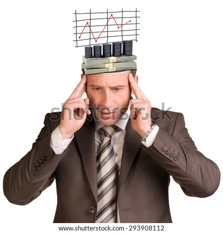 Thoughtful businessman looking down with graph and money in his head on isolated white background #293908112