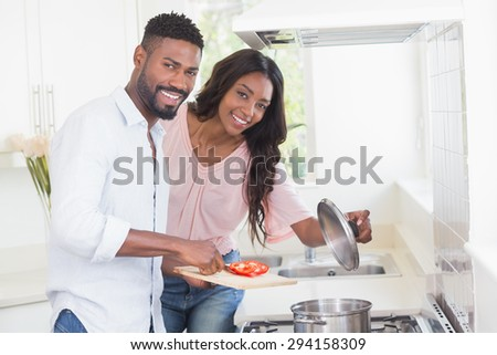 Happy couple cooking food together at home in the kitchen #294158309