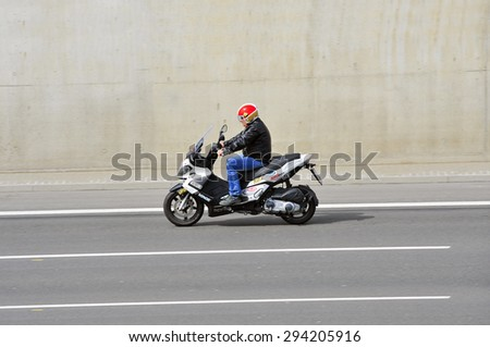FRANKFURT,GERMANY - APRIL 16:unknown rider on the highway on April 16,2015 in Frankfurt, Germany. #294205916