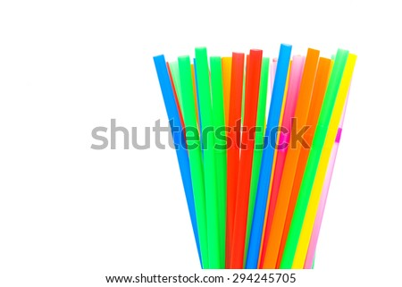 Colorful plastic drinking straws in glass on white background #294245705