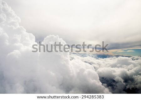 Clouds and sky as seen through window of an aircraft #294285383