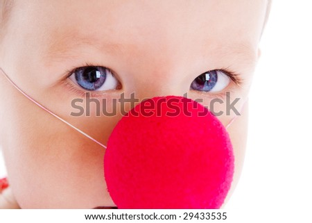 Baby with red clown nose on, shot closeup #29433535