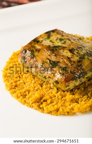 grilled fish with manioc flour #294671651