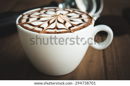 Latte art in white cup on the wooden background #294738701