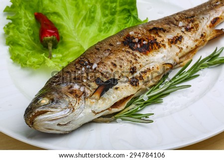Grilled trout with rosemary and salad leaves #294784106