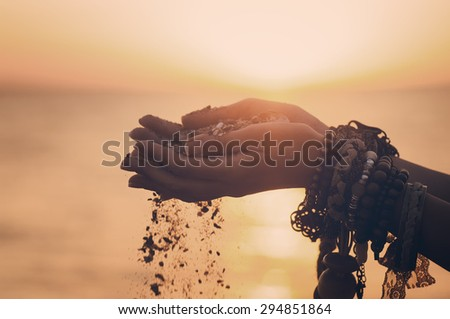 young woman hands holding sand on the beach. natural vintage  summer background #294851864