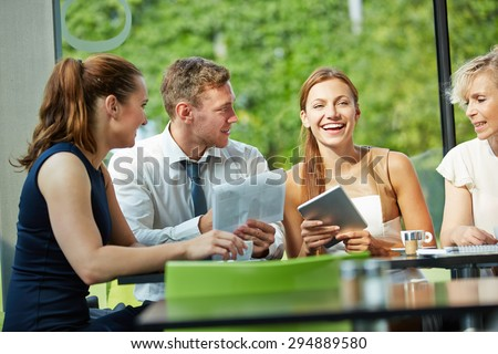Young businesswoman laughing in business team meeting #294889580