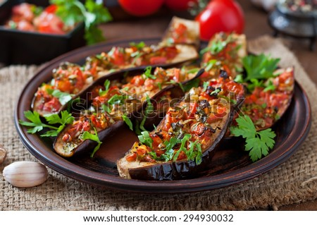 Baked eggplant with tomatoes, garlic and paprika #294930032