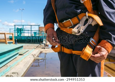 Builder Worker in safety protective equipment on bridge construction #294951353