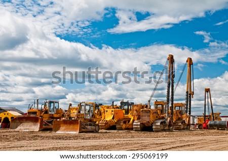Many orange machines standing on the ground Royalty-Free Stock Photo #295069199