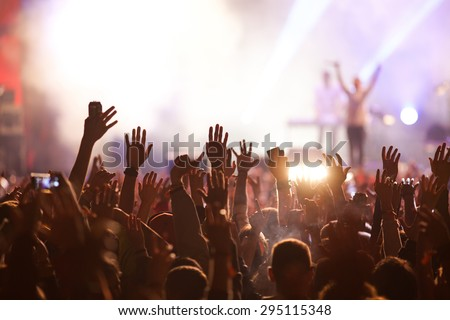 Crowd at concert and blurred stage lights Royalty-Free Stock Photo #295115348