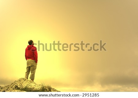 man in meditation on top of the mountain at sunset #2951285