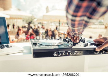 dj mixer close up while he is mixing. concept about party, music, fun and people Royalty-Free Stock Photo #295208201