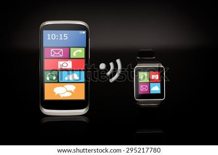 Modern internet smart watch and smartphone on black background. #295217780