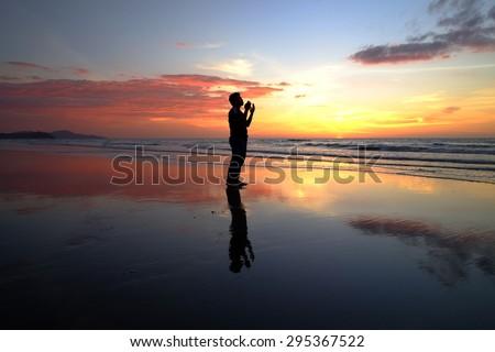 silhouette of man praying during sunset. #295367522