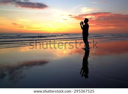 silhouette of man praying during sunset. #295367525