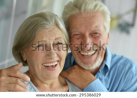 Portrait of a happy senior couple at home #295386029