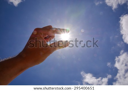 Picture of an Hand over the Sky and Sun