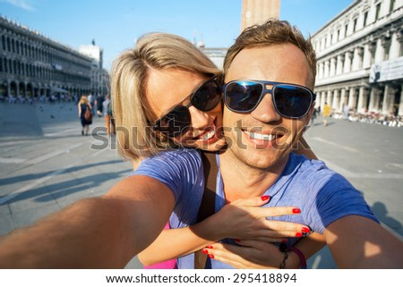 Smiling couple making selfie photo