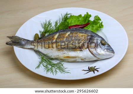 Grilled dorado with salad leaves and dill #295626602