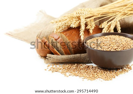 Ears of wheat and bowl of wheat grains on white background #295714490