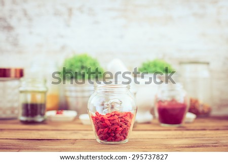 Goji berry (wolfberry) on wooden table #295737827