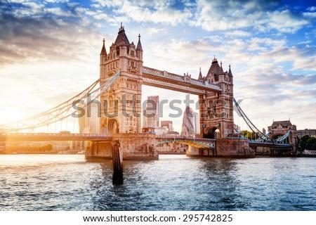 Tower Bridge in London, the UK. Sunset with beautiful clouds. Drawbridge opening. One of English symbols Royalty-Free Stock Photo #295742825