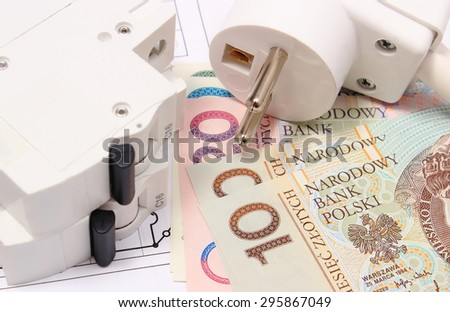 Electric fuse and plug with money on electrical construction drawing of house, accessories for engineering work, concept for energy saving #295867049