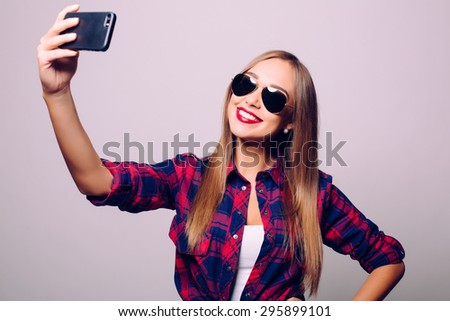 Selfie time. Joyful young women making selfie by her smart phone and smiling  #295899101