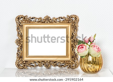 Baroque golden picture frame and rose flowers. Vintage style mockup with space for your picture or text