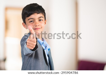 Child with thumb up inside house #295904786