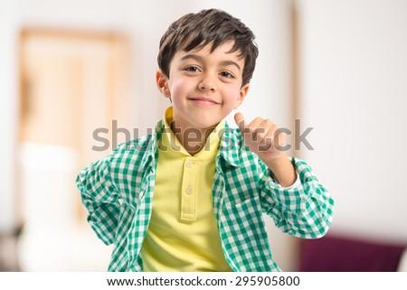 kid doing victory gesture #295905800