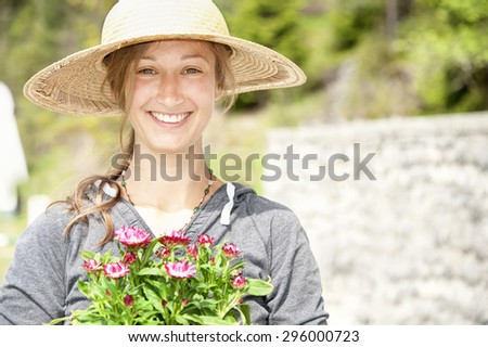 Gardening lady with a sunhat #296000723