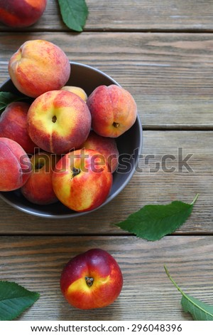 fresh and ripe peaches in bowl, fruits on boards #296048396