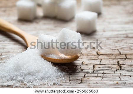 white sugar in wood spoon on wood table #296066060