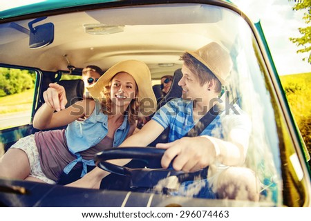 Beautiful young people on a road trip on a summers day #296074463