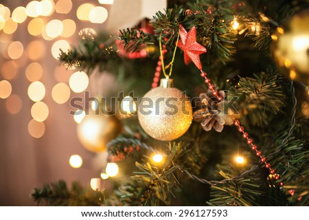 Christmas Room Interior Design, Xmas Tree Decorated By Lights Presents Gifts Toys, Candles And Garland Lighting Indoors  #296127593